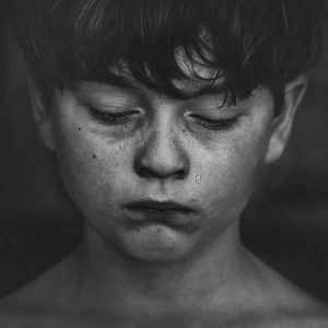 young boy's face with tears