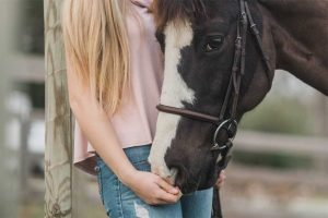 girl caring for horse